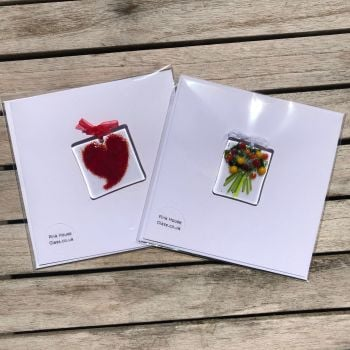 Two cards, one with a red Heart and one with a red flower Bouquet.