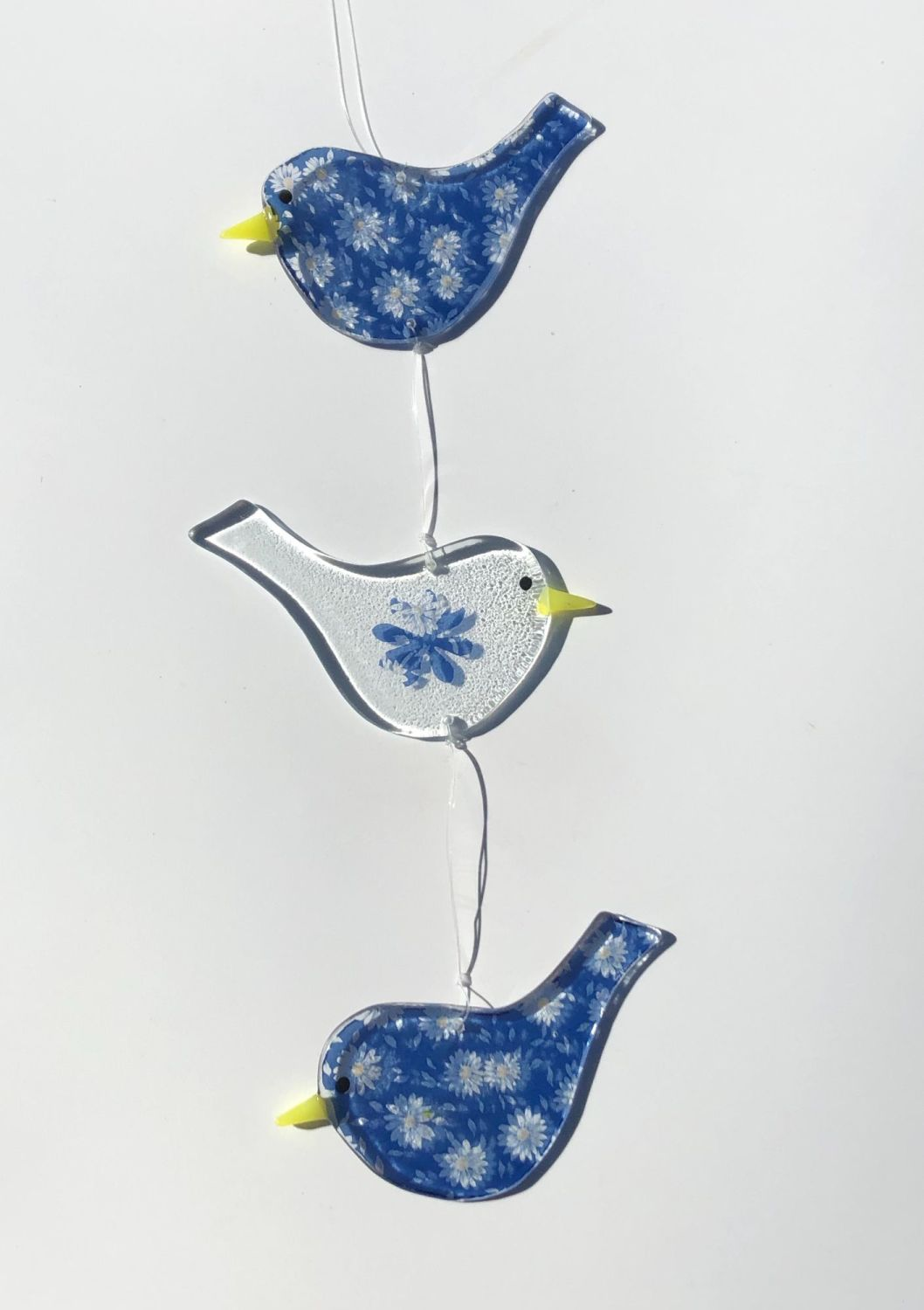 Trio of hanging Birds with blue and white daisy pattern