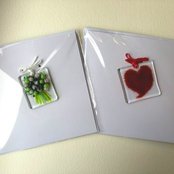 Two cards, one with a red heart and one with a pink flower bouquet.