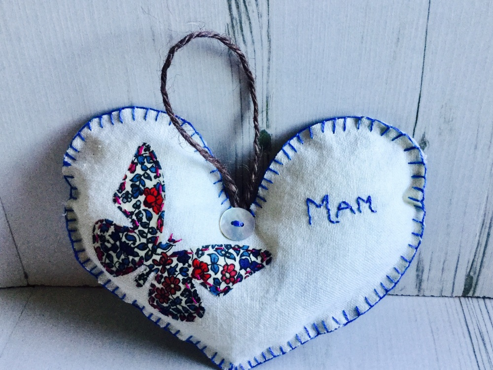 Embroidered heart with butterfly design