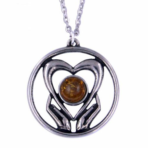 Holding onto love pendant by St Justin of Penzance