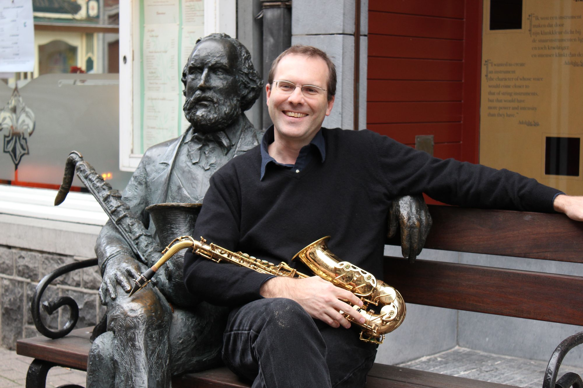 Kyle Horch photo with Adolphe Sax statue
