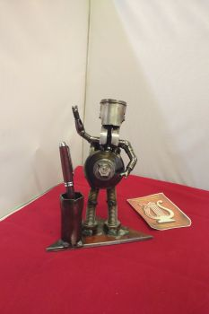 Piston person pen holder. Metal Sculpture
