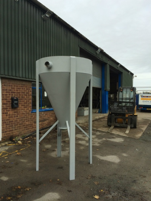 finished painted  feed hopper made by Lynx engineering