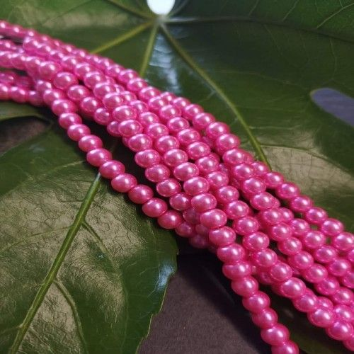 Hot Pink glass pearl strand 6mm