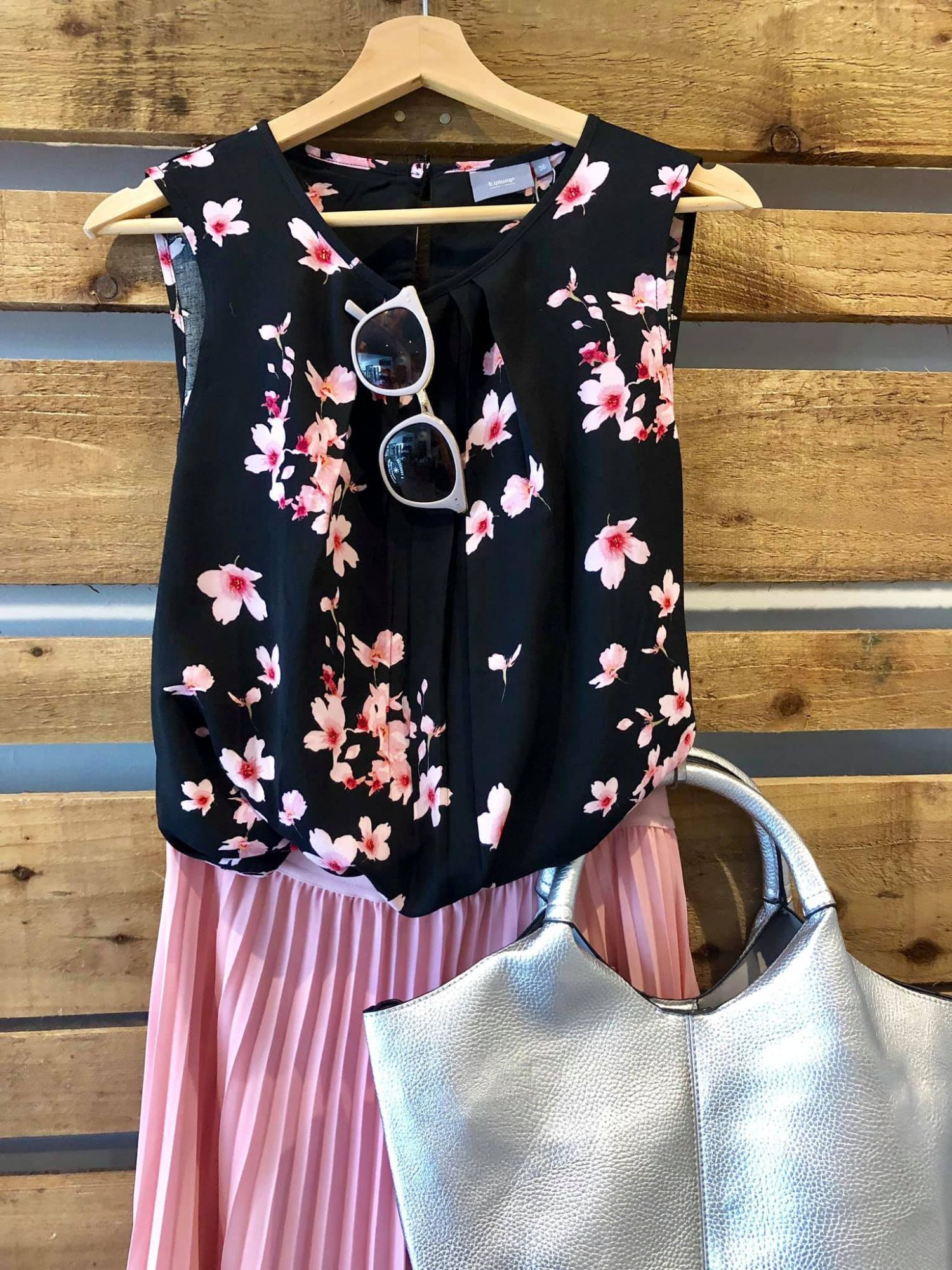 Pink flowered top and pleated skirt
