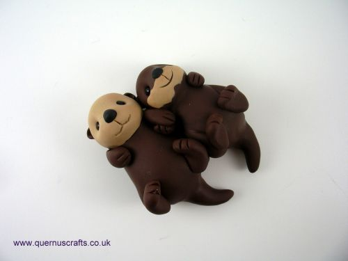 Wee Cuddling Sea Otters QL9