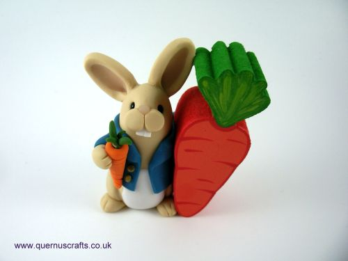 Little Peter Bunny with Wooden Carrot QL9