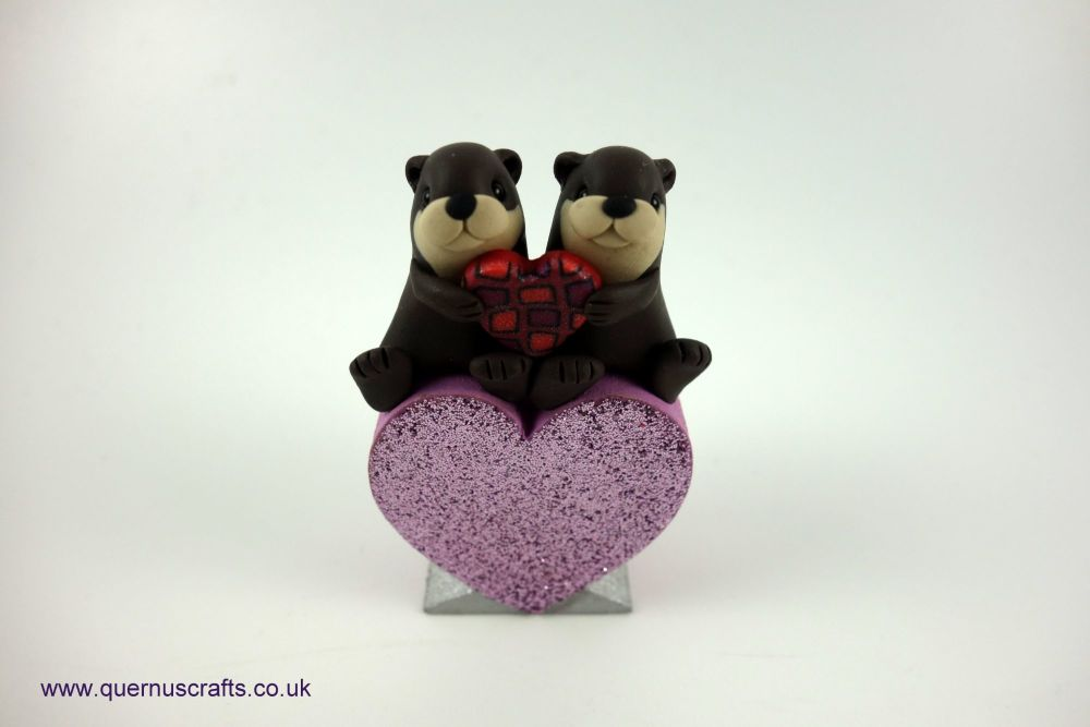 Teeny Love Otter Couple on Pale Pink Heart