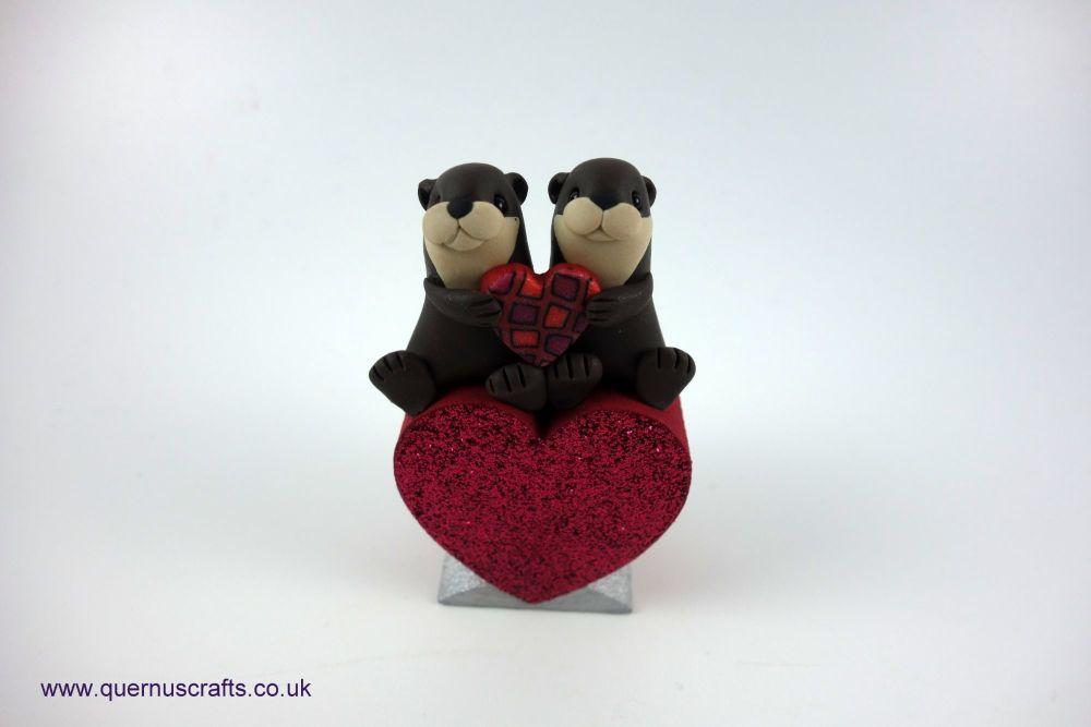 Teeny Love Otter Couple on Dark Pink Heart