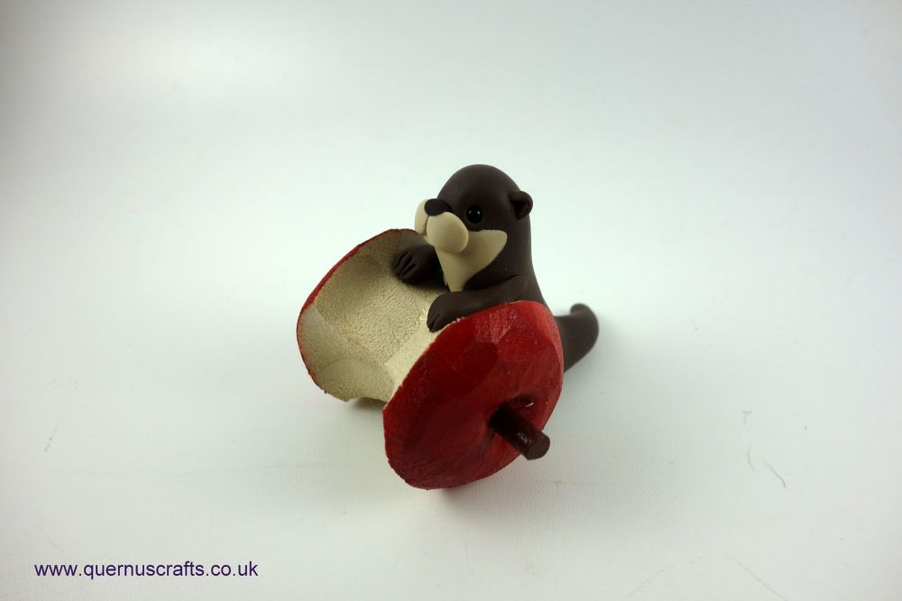 Little Otter with Apple Core