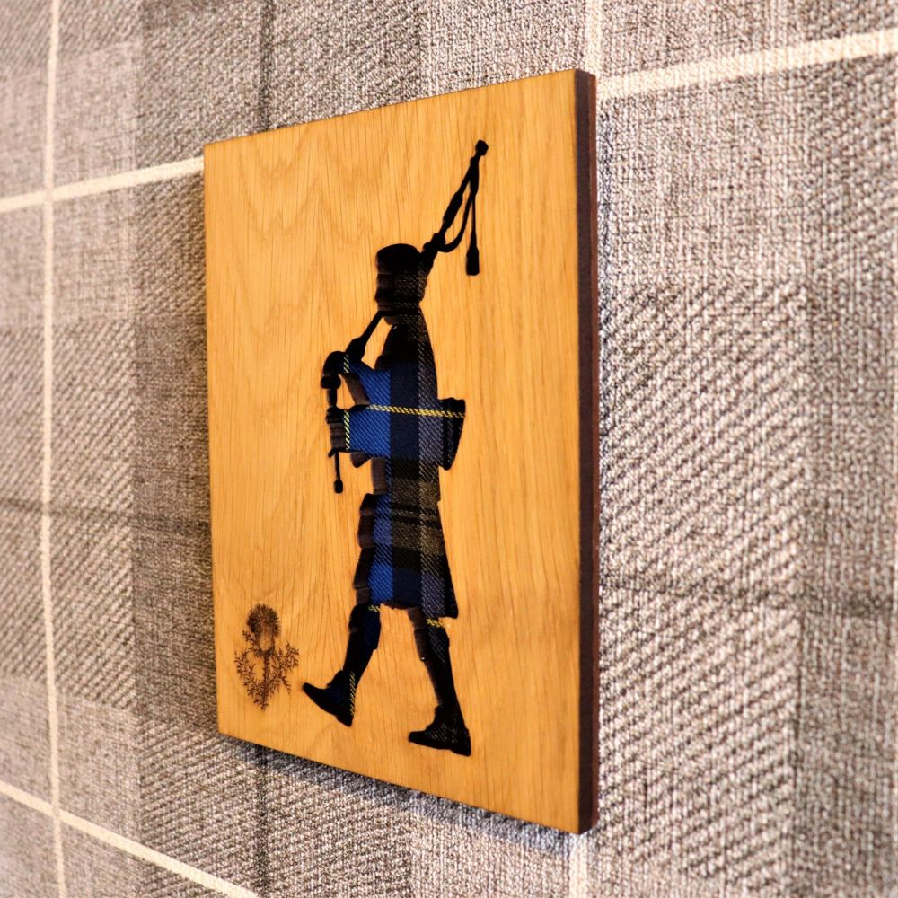 Scottish Piper Wall Art with Engraved Thistle & Tartan Inlay. Side on.
