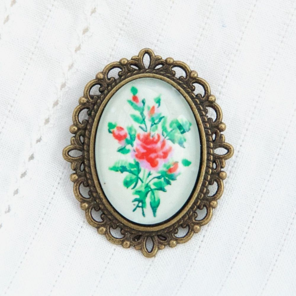Victorian 'Arsenical wallpaper' floral oval brooch