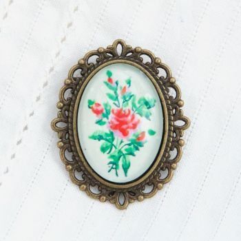 Victorian 'Arsenical wallpaper' roses oval brooch