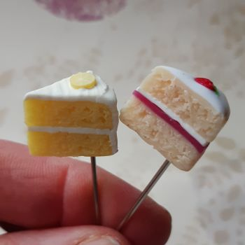 Two cake themed decorative pins