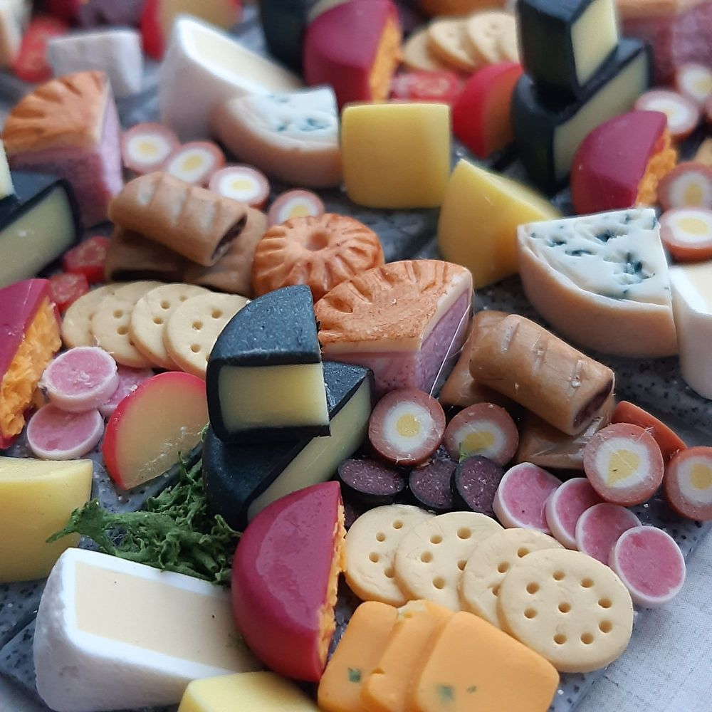 Grazing board in miniature with cheese and pork pie