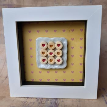 Square plate of biscuits with yellow background.