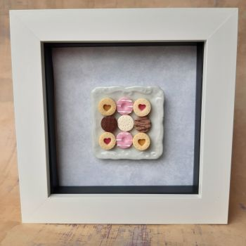 Square plate of biscuits (Pale background)