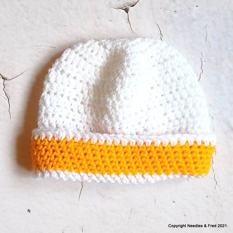 White hat with yellow trim