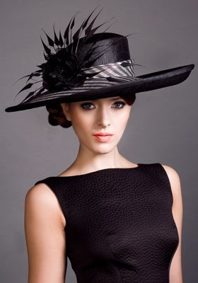Stunning black hat with beautiful feather detail