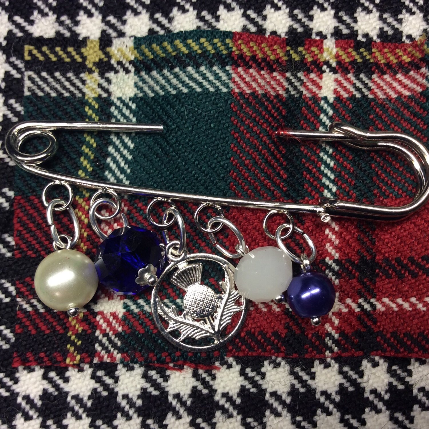 scottish thistle kilt pin with blue and white faceted