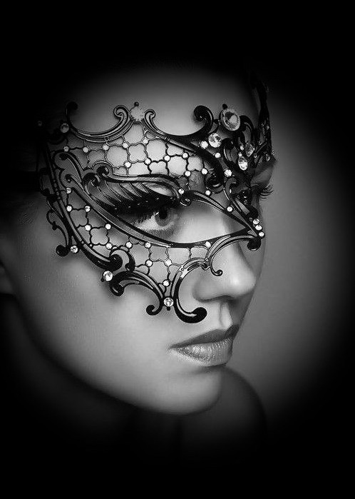 image of a woman wearing a black filigree phantom mask