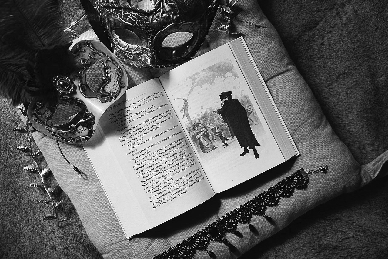 image of a book showing the history of venetian masks