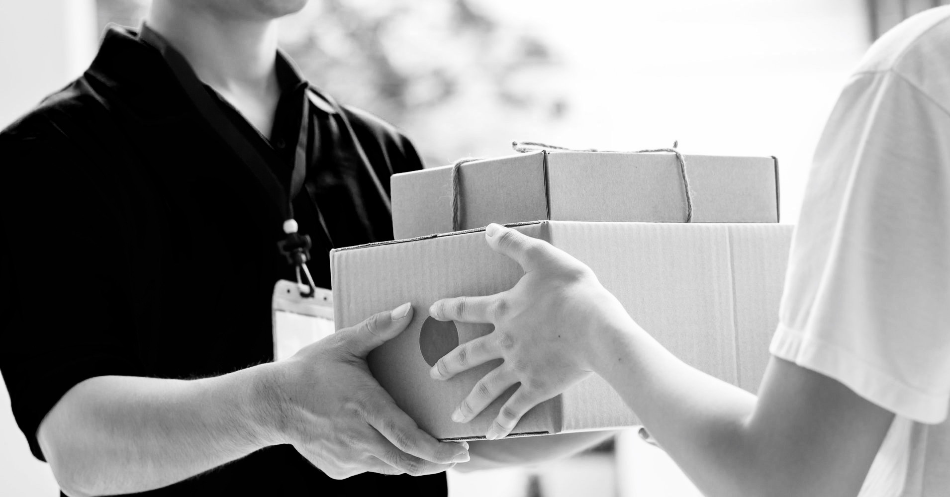 postal worker handing over parcels to a customer