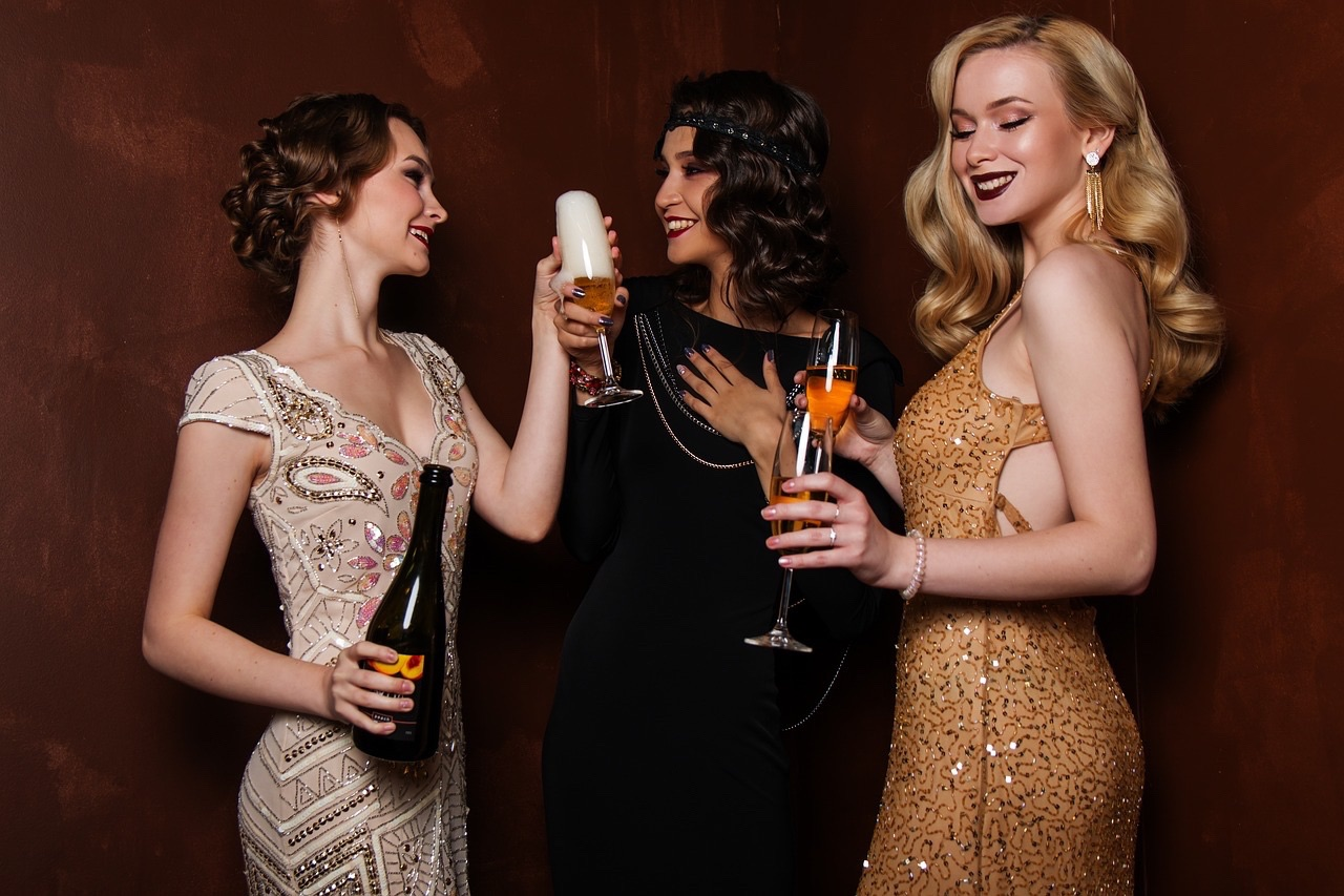 Group of three woman enjoying fizz at a party