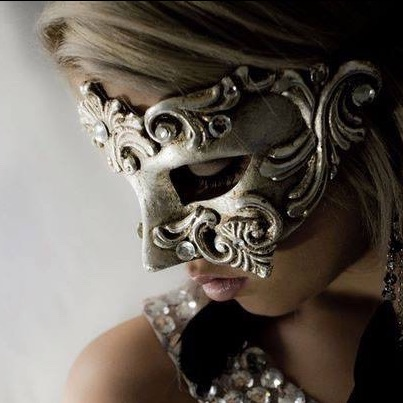 blonde woman wearing a luxury masquerade mask