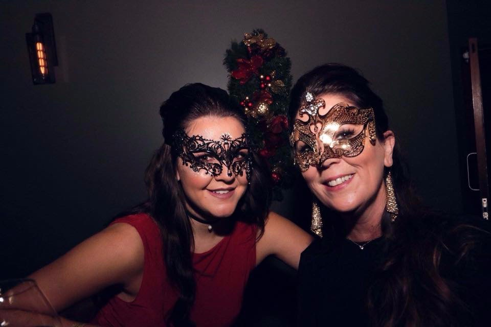 image of two women customers at a masquerade ball