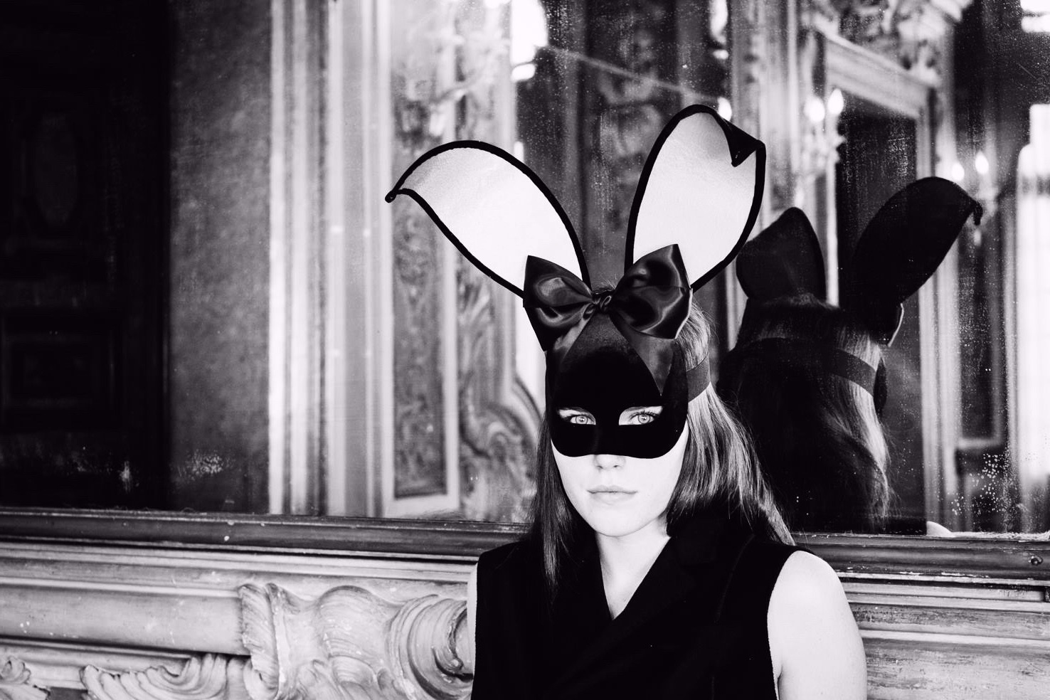 stunning dark haired woman wearing a bunny girl mask