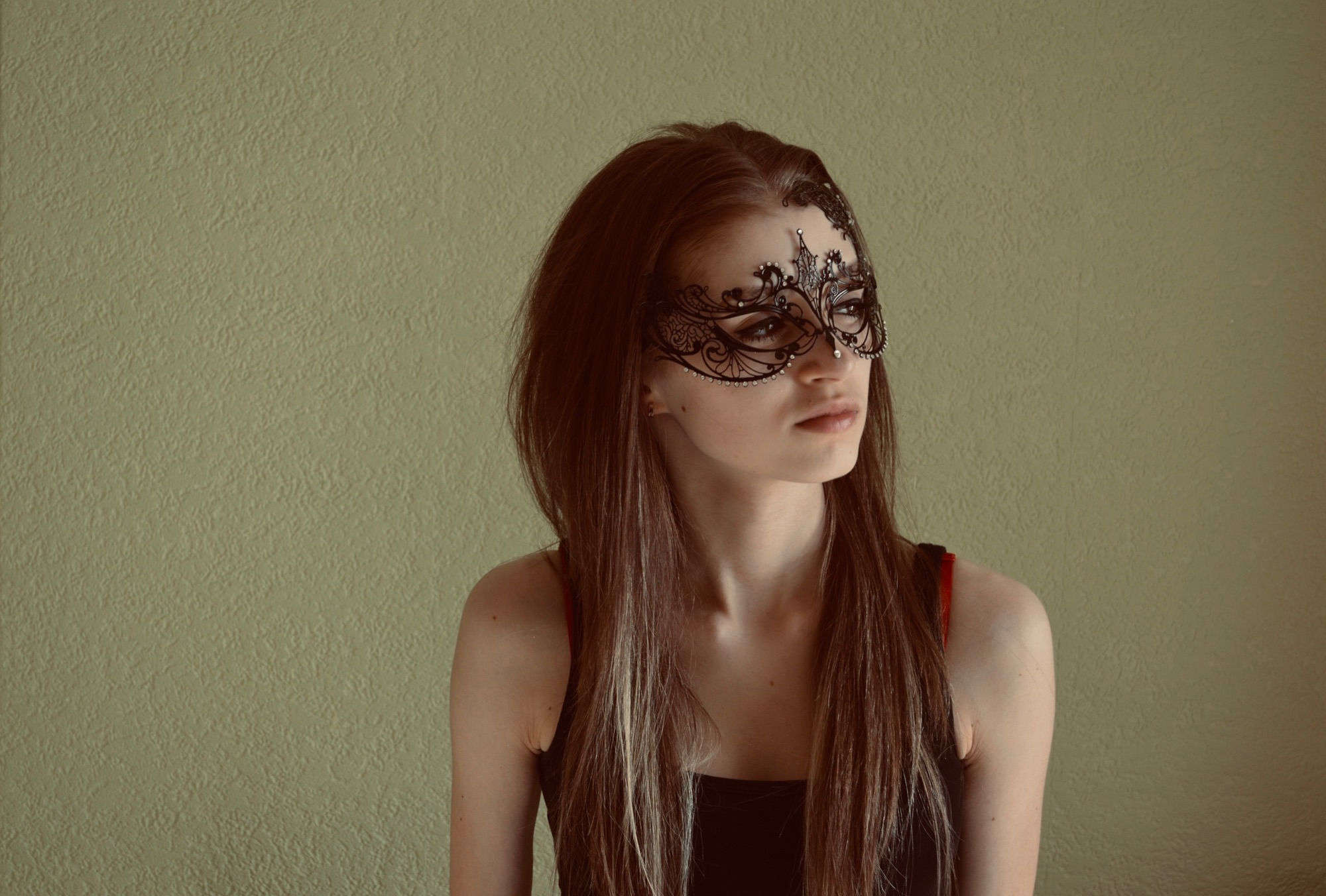 girl wearing a masked ball mask for her school project