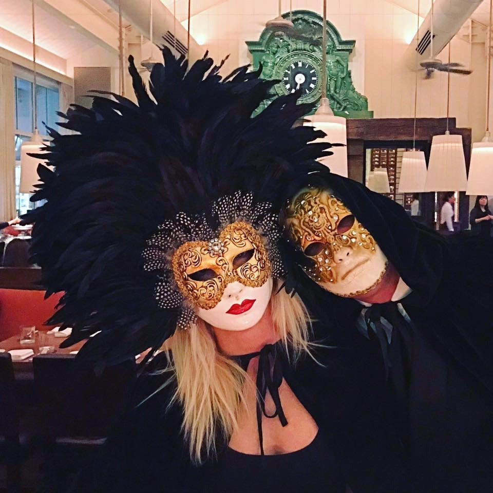 "two customers of ours wearing his & hers ""eyse wide shut"" movies masks"