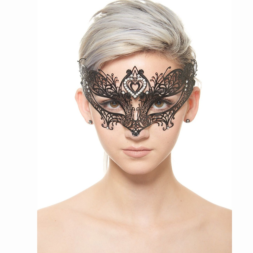 beautiful young girl with grey hair  wearing a black filigree mask  and showing what it looks like on