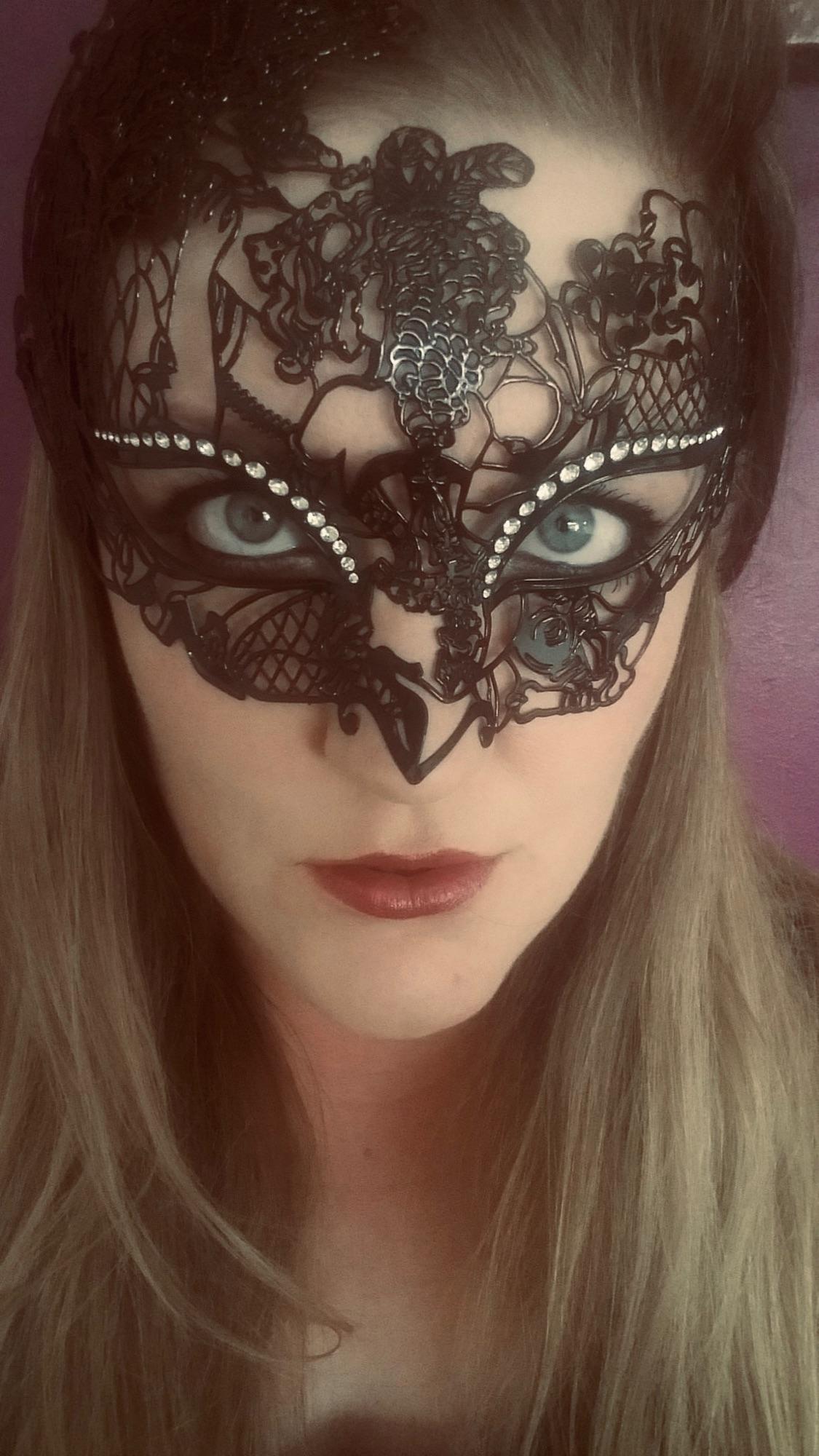 beautiful lady customer  wearing a filigree masked ball mask - Image