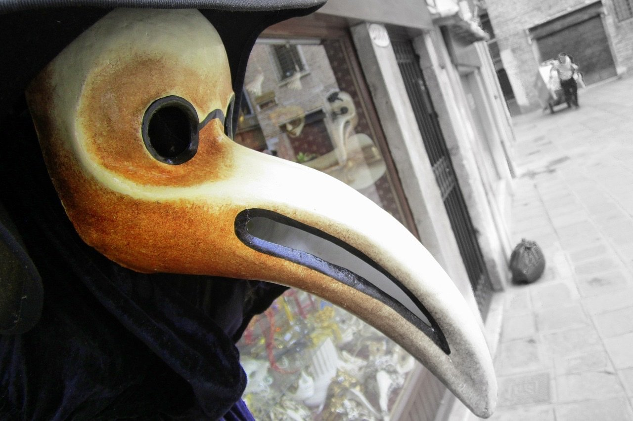 A classic plague doctor mask and costume outside a  shop in Venice, Italy