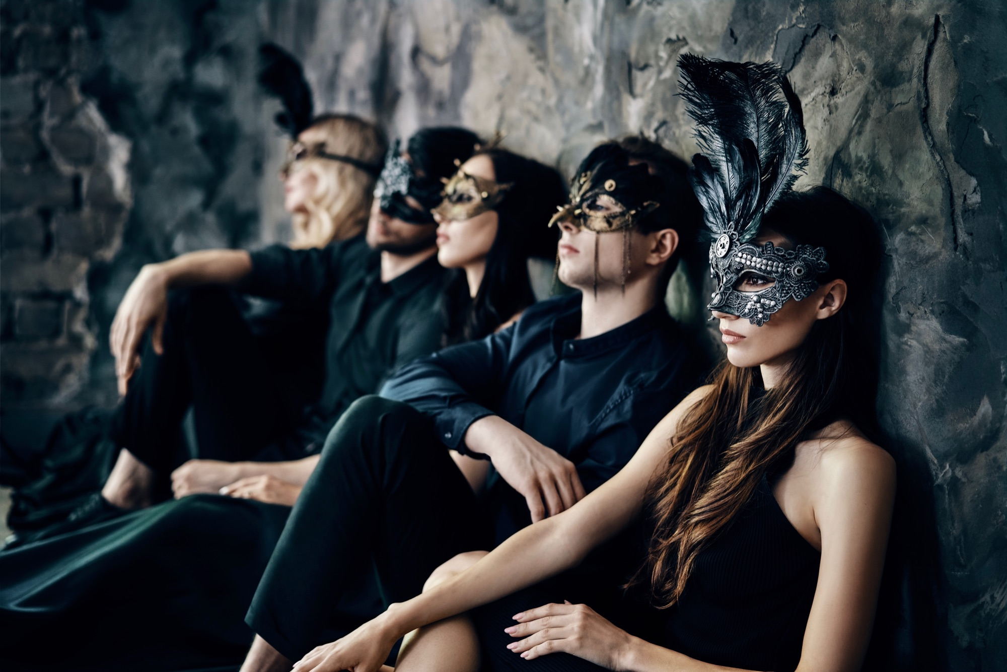 Group of 5 friends enjoying themselves at a masquerade ball