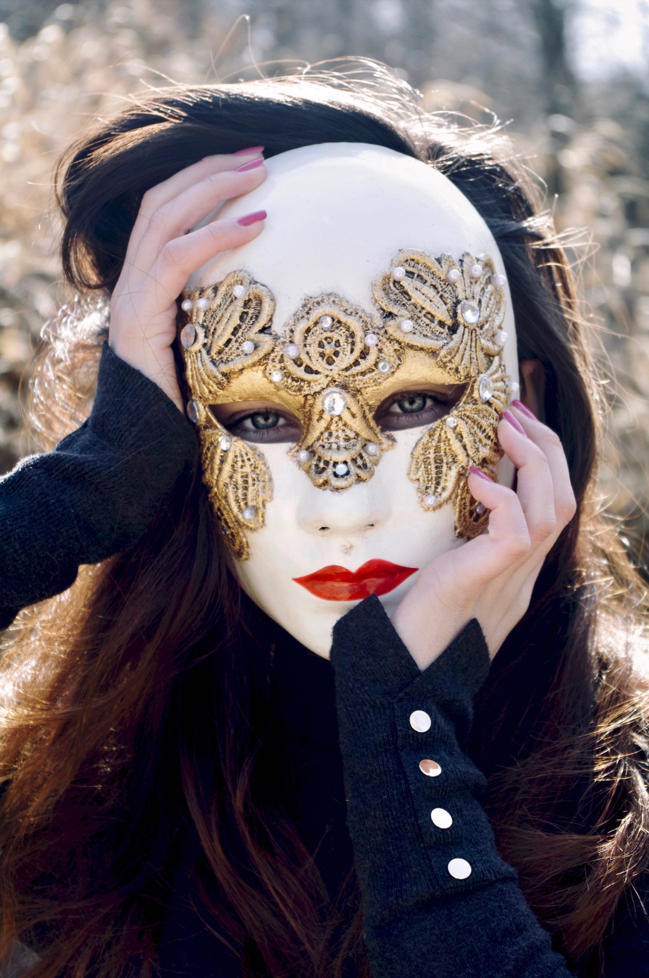 stunning dark haired woman wearing one of our full face venetian masks