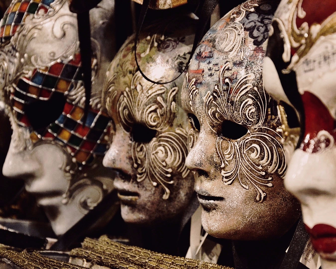 stunning venetian masks on a wall of a shop in Venice, Italy