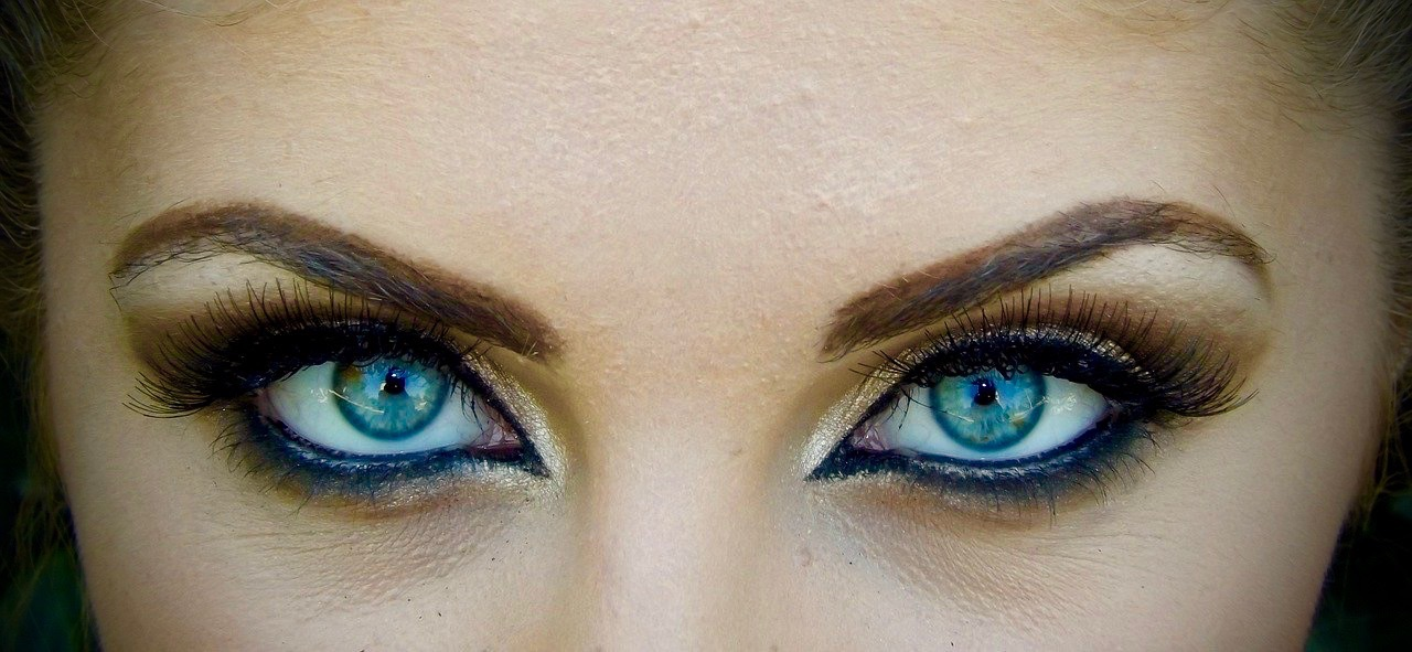 beautiful eyes of a woman showing off her makeup ready for a masked ball