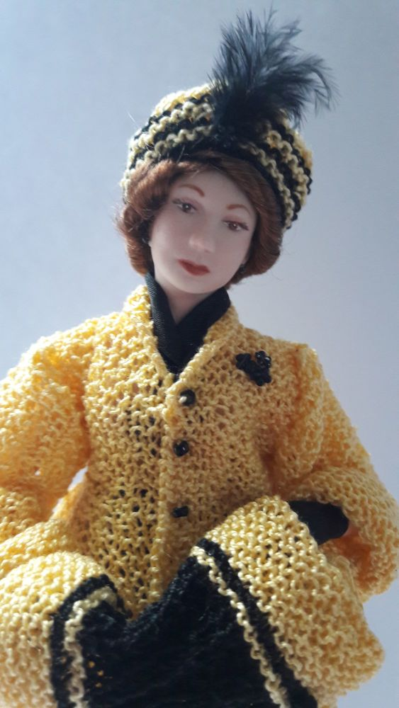 Late Edwardian lady in knitted coat