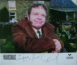 Geoffrey Hughes autograph (hand-signed Heartbeat cast card, dedicated)