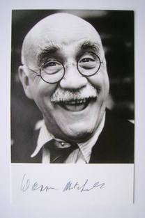 Warren Mitchell autographed photo