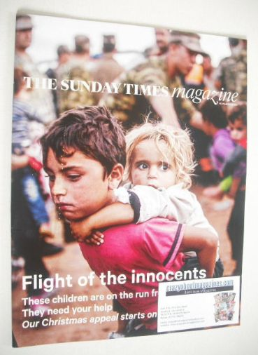 <!--2014-11-23-->The Sunday Times magazine - Flight Of The Innocents cover