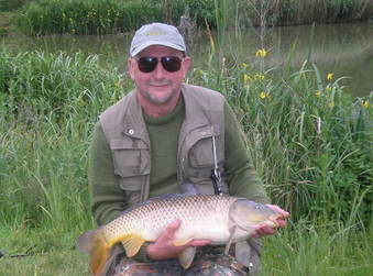 Les Smith & his 16lb Common Carp