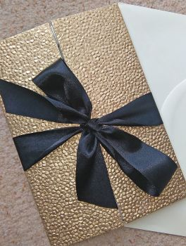 Sequin paper and bow gatefolds