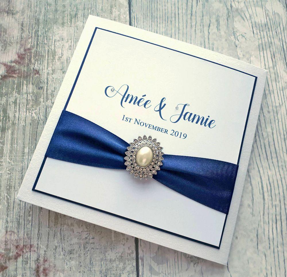 Wide ribbon & large gem pocket folds