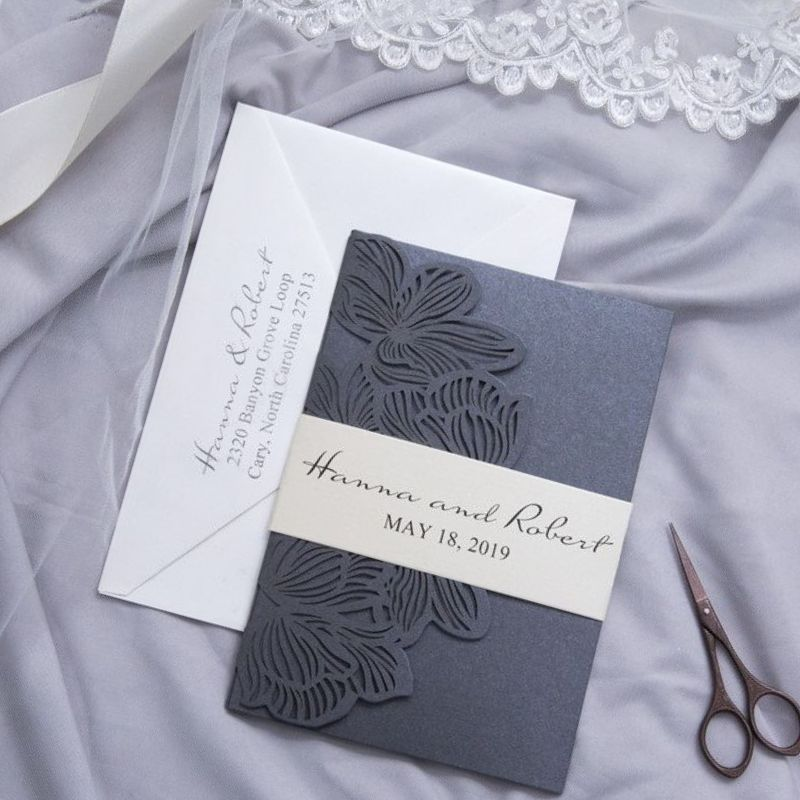 Laser cut pocket fold invitation with wrap