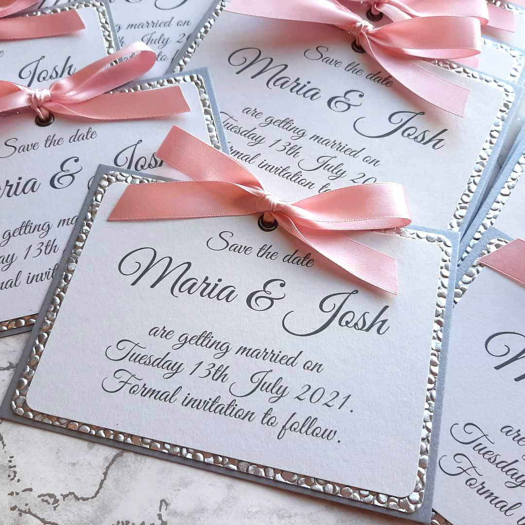 Eyelet and bow save the dates